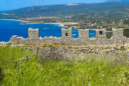 The walls with the Ionian sea in the background